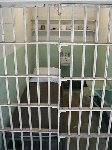 Prison cell with bed inside Alcatraz main building san francisco california