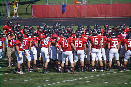 'Huddle Up' -- Barrington Broncos High School Varsity Football Team Homecoming Game September 2014