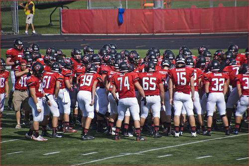 'Huddle Up' -- Barrington Broncos High School Varsity Football Team Homecoming Game September 2014